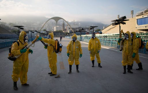 Health workers spray insecticide to combat the mosquitoes that transmit the Zika virus at the Sambadrome in Rio de Janeiro, Brazil, Tuesday, January 26, 2016. (AP Photo / Leo Correa) Image via thenation.com.